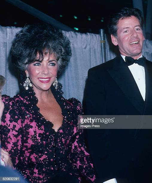 Elizabeth Taylor and Calvin Klein attends a reception of amfAR's AIDS: To Care Is To Cure campaign at the Jacob Javits Center on April 29, 1986 in...
