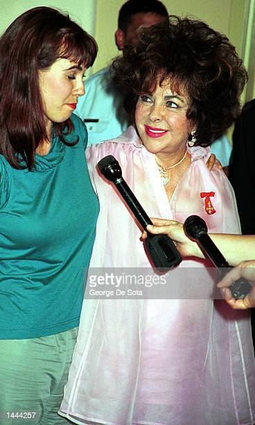 Elizabeth Taylor and her granddaughter Naomi are interviewed as they attend the benefit by the American Foundation for Aids Research known as...