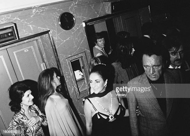 Elizabeth Taylor and her husband Richard Burton at Burton's 50th birthday party held at the Dorchester Hotel London 10th November 1975
