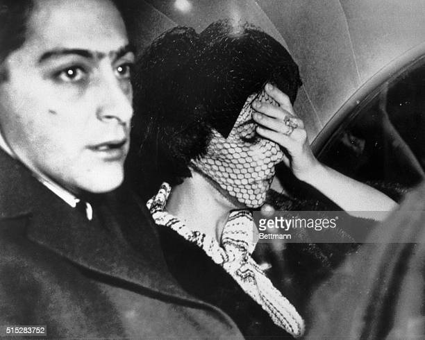 Elizabeth Taylor and her stepson Mike Todd Jr arrive in Chicago for the funeral of her third husband Mike Todd who died in a plane crash near Grants...