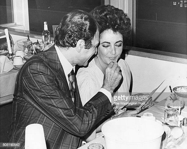 FILE Elizabeth Taylor and Iranian Ambassador Ardeshir Zahedi at the Rosecroft Raceway in Oxon Hill Maryland on May 5 1976