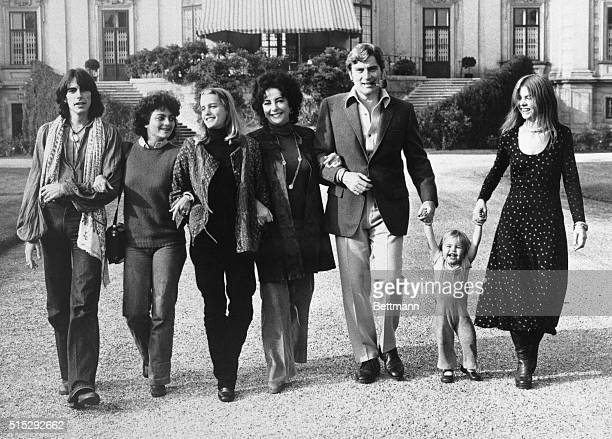 Elizabeth Taylor and John Warner walk arm in arm with their children from a variety of marriages after they announced their engagement
