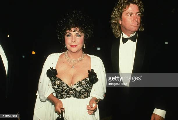 Elizabeth Taylor and Larry Fortensky attends the Benefit for the American Foundation for AIDS Research at the Waldorf Astoria on November 30 1990 in...