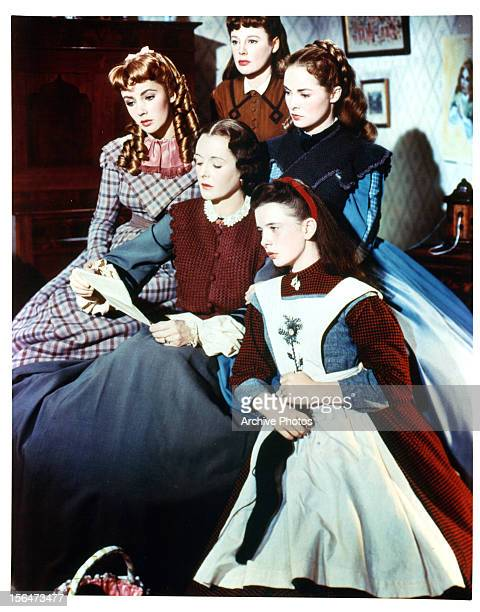 Elizabeth Taylor and Margaret O'Brien to a letter being read to them and the rest of the girls in a scene from the film 'Little Women', 1949.