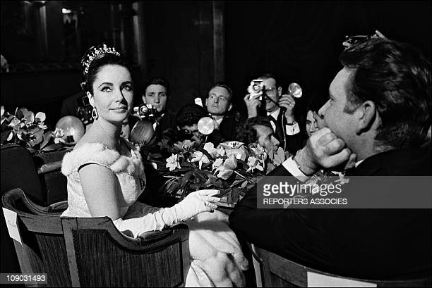 Elizabeth Taylor and Richard Burton at the film premiere of ''Lawrence of Arabia'' on March 16, 1963 in Paris, France.