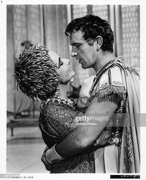 Elizabeth Taylor and Richard Burton embrace in a scene from the film 'Cleopatra', 1963.