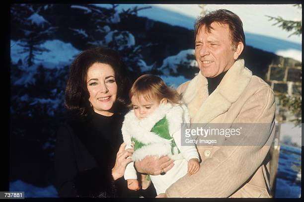 Elizabeth Taylor and Richard Burton hold their granddaughter Leyla January 15 1973 in Gstaad Switzerland Elizabeth Taylor and husband Richard Burton...