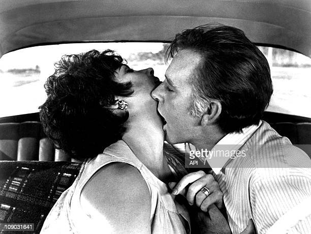 """Elizabeth Taylor and Richard Burton in the film """"The Comedians"""", directed by Peter Glenville in 1967."""