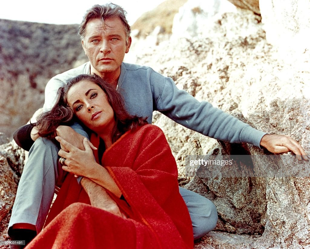 Elizabeth Taylor and Richard Burton on the film set of 'The Sandpiper' in 1965.