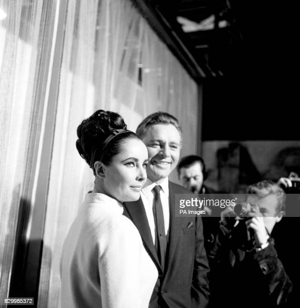 """Elizabeth Taylor and Richard Burton, who play man and wife in the """"The V.I.P.'s"""" the new film being made at MGM's British studios at Borehamwood,..."""