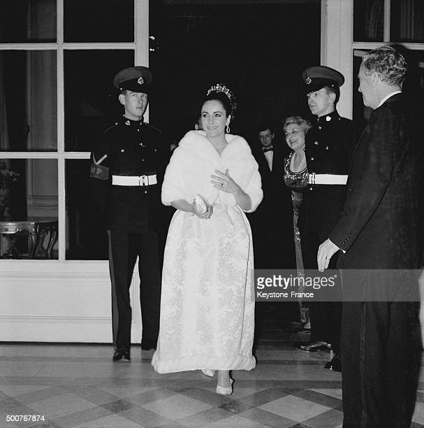 Elizabeth Taylor arrives at the gala for the movie 'Lawrence of Arabia' on March 16 in Paris, France.