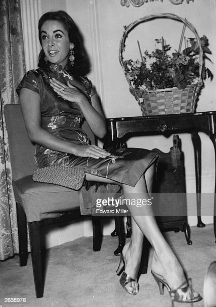 Elizabeth Taylor at a press reception at the Dorchester Hotel held for her and her husband Mike Todd