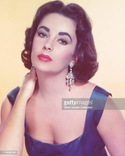 Elizabeth Taylor British actress in a studio portrait against a pale yellow background circa 1955