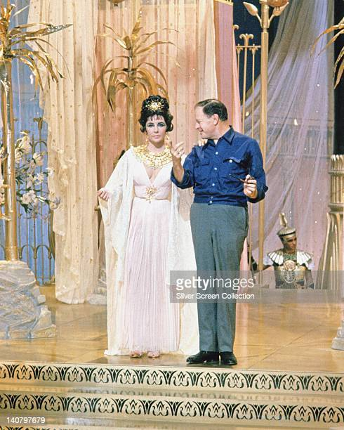 Elizabeth Taylor British actress in costume and Joseph L Mankiewicz US film director on the set of the film 'Cleopatra' 1963 The historical drama...
