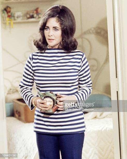 Elizabeth Taylor British actress wearing a blue and white striped top and holding an ornamental teapot in a publicity still issued for the film 'The...