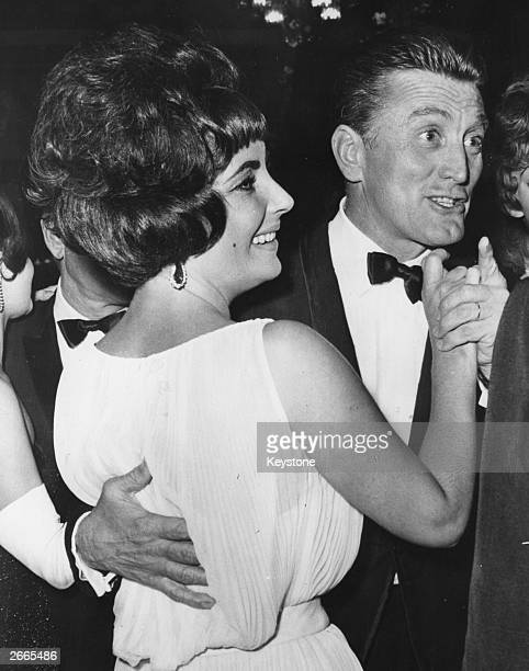 Elizabeth Taylor dancing with Kirk Douglas at the party in Rome for the film 'Spartacus'.