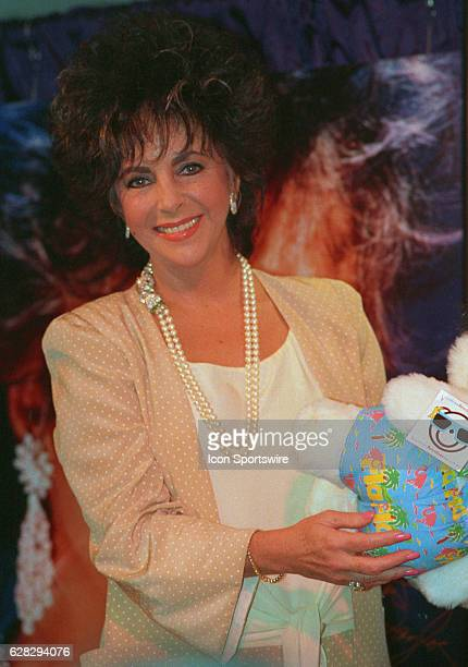Elizabeth Taylor during a promotional appearance promoting her perfume PASSION