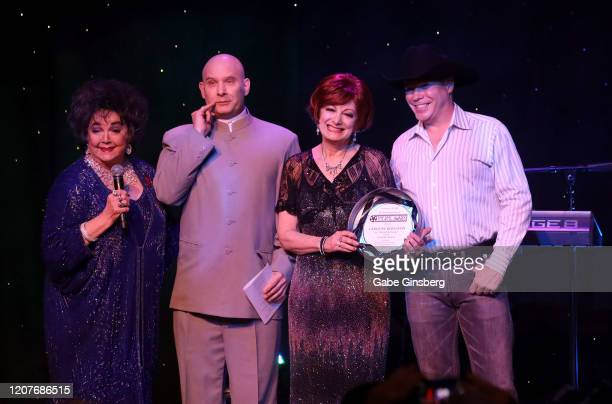 """Elizabeth Taylor impersonator Louise Gallagher Smith of California, Stephan Zmijak of Ontario, dressed as the character Dr. Evil, from """"Austin..."""
