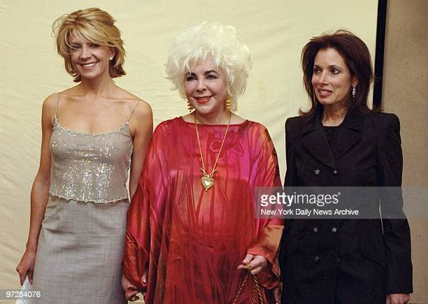 Elizabeth Taylor is flanked by actress Natasha Richardson and Patricia Hambrecht president of Christie's at an American Foundation for AIDS Research...