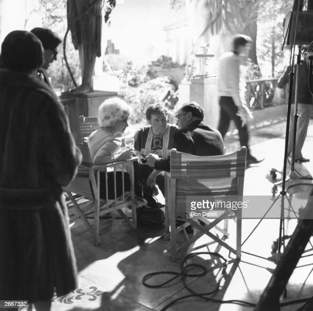 Elizabeth Taylor Richard Burton and director Joseph L Mankiewicz on the set of the film 'Cleopatra' produced by 20th Century Fox