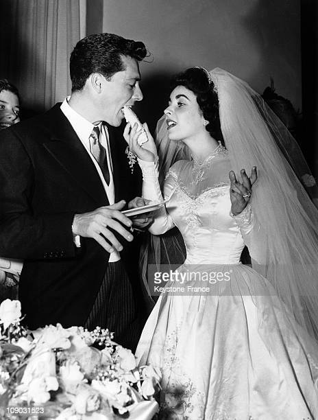 Elizabeth Taylor serves her new husband Conrad Hilton Jr cake during their wedding reception on June 5 1960 in Los Angeles America