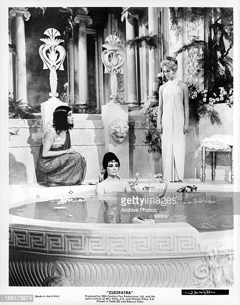 Elizabeth Taylor sitting in bath in a scene from the film 'Cleopatra' 1963