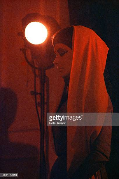 Elizabeth Taylor takes a break on the 'Cleopatra' set at the Cinecitta Studio just outside Rome Italy in February 1962 'Cleopatra' was directed by...