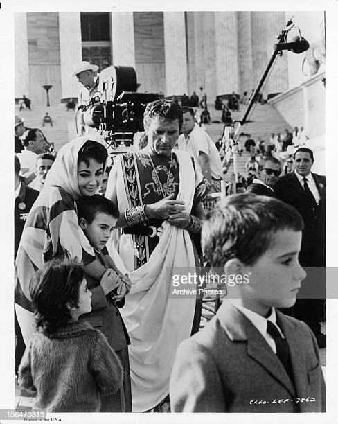 Elizabeth Taylor with children with Richard Burton on the right on set of the film 'Cleopatra' 1963