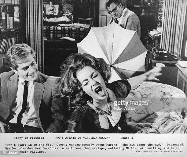 "Elizabeth Taylor yells as George Segal and Richard Burton in a scene from the Warner Bros movie ""Who's Afraid of Virginia Woolf ?"" circa 1966."