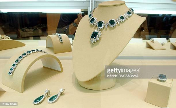 Elizabeth Taylor's emerald diamond and platinum necklace with matching bracelet and ear rings sit on display at Christie's for the first time in...