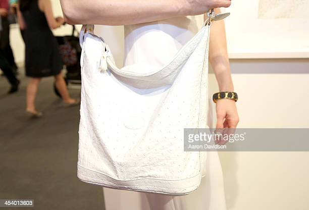Elizabeth TenHouten wearing a vintage Gucci purse GURHAN jewelry and a BCBG dress attends Art Basel Miami Beach 2013 at the Miami Beach Convention...