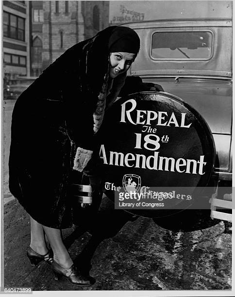 Elizabeth Thompson a member of The Crusaders puts a tire cover on her car that demands the repeal of the 18th amendment in Chicago Illinois