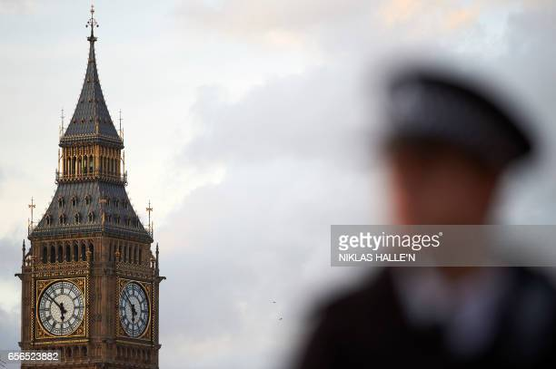 TOPSHOT Elizabeth Tower is seen at the Houses of Parliament in central London on March 22 2017 as emergency services deal with the aftermath of a...