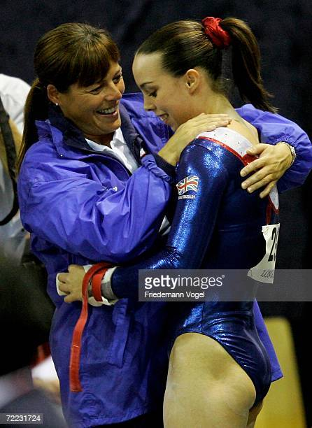 Elizabeth Tweddle Of Great Britain Celebrates With Her Coach After Performing On The Horizontal Bar In