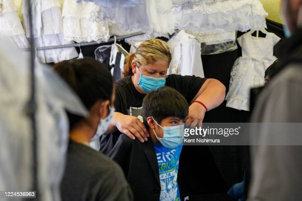 Elizabeth Vargas helps a customer with a fitting at her stall at the Paramount Swap Meet on Saturday, June 27, 2020 in Paramount, CA. Swap Meets...
