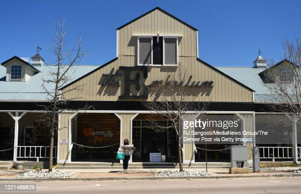 Elizabeth Villwock manager of The Emporium a specialty gift shop stands outside the shop on April 27 2020 in Castle Rock Colorado The shop is...