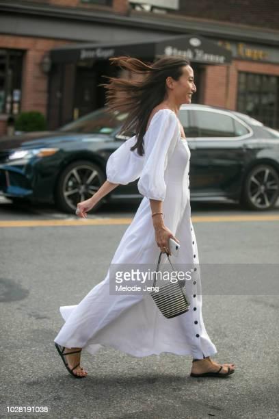 Elizabeth Von Der Goltz wears a white dress at the Ulla Johnson show on Day 1 of New York Fashion Week Spring/Summer 2019 on September 6, 2018 in New...