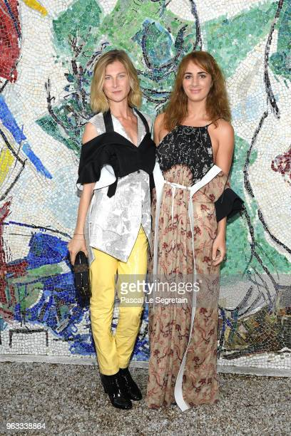 Elizabeth Von Guttman and Alexia Niedzielski attend Louis Vuitton 2019 Cruise Collection at Fondation Maeght on May 28 2018 in SaintPaulDeVence France