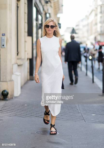 Elizabeth von Guttman wearing a white dress, sandals outside Valentino during Paris Fashion Week - Haute Couture Fall/Winter 2017-2018 : Day Four on...