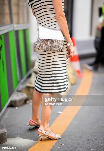 Elizabeth von Guttman wearing striped dress silver bag is seen outside Hermes Resort during Paris Fashion Week Haute Couture FW18 on July 1 2018 in...