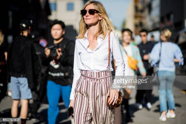 Elizabeth von Guttman wearing white blouse striped high waisted pants is seen outside Gucci during Milan Fashion Week Spring/Summer 2018 on September...