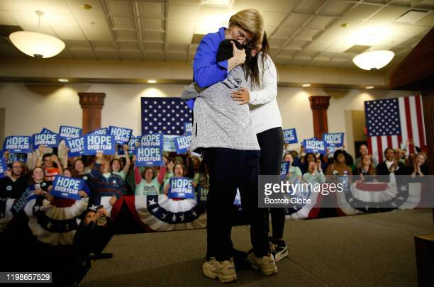 Elizabeth Warren embraces her grandchildren Atticus and Lavinia as she arrives at a Caucus Rally in Des Moines IA on Feb 3 2020 The Iowa Democratic...