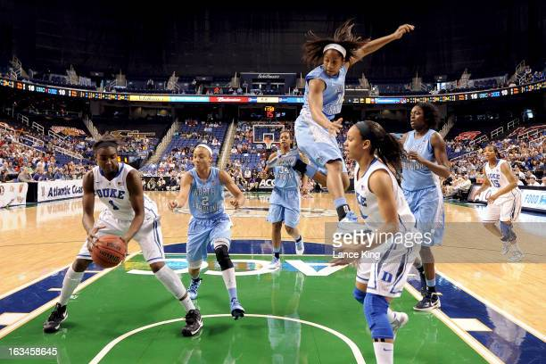 Elizabeth Williams catches a pass from Chloe Wells of the Duke Blue Devils against the North Carolina Tar Heels during the finals of the 2013 Women's...