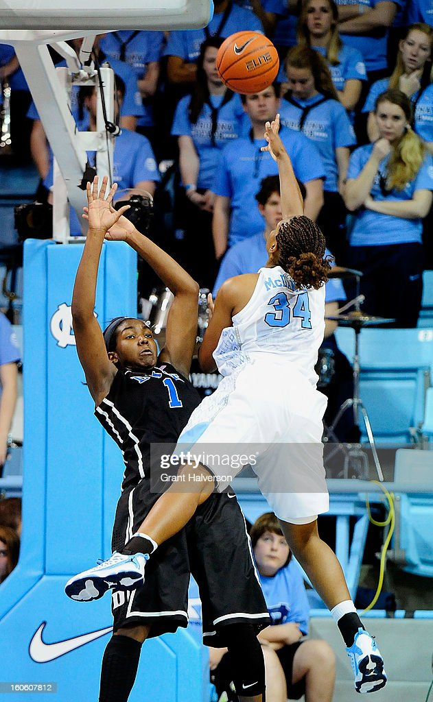 Elizabeth Williams #1 of the Duke Blue Devils draws a charging foul against Xylina McDaniel #34 of the North Carolina Tar Heels during play at Carmichael Arena on February 3, 2013 in Chapel Hill, North Carolina.
