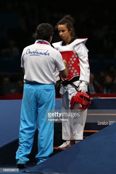 Elizabeth Zamora Gordillo of Guatemala speaks with her coach during the Women's 49kg Taekwondo bronze medal match against Chanatip Sonkham of...