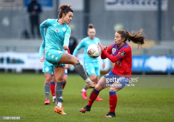 Elizabetha Ejupi of London City Lionesses looks to break past Emma Doyle of Blackburn Ladies during the Barclays FA Women's Championship match...