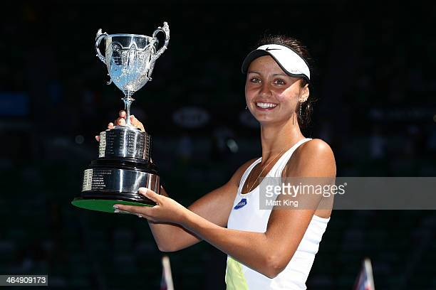 Elizaveta Kulichkova of Russia poses with the winners trophy after winning her Junior Girls' Singles Final against Jana Fett of Croatia during day 13...