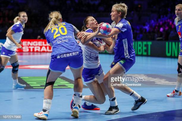 Elizaveta Malashenko of Russia is trying to shoot the ball against Isabelle Gullden and Elin Hallagard of Sweden during the EHF Women's Euro main...