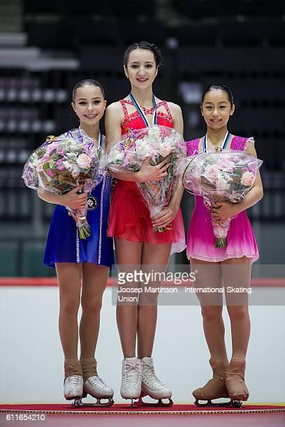 Elizaveta Nugumanova and Polina Tsurskaya of Russia and Mako Yamashita of Japan pose for a photo during the Junior Ladies Medal Ceremony on day two...
