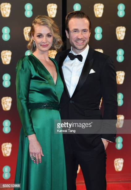 Elize Du Toit and Rafe Spall attend the 70th EE British Academy Film Awards at the Royal Albert Hall on February 12 2017 in London England